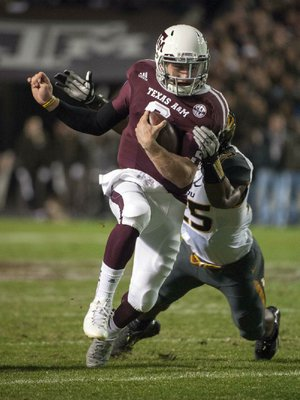 Texas A&M freshman quarterback Johnny Manziel (2) has collected 4,060 yards of total offense, made himself a serious Heisman Trophy contender and led the No. 9 Aggies to a 10-2 record in their first SEC season. The Aggies, who have a rule prohibiting freshmen from talking to the media, lifted the restriction for Manziel on Monday.