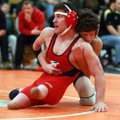 Joey Adams (right), then with Springdale Har-Ber, wrestles Russellville's Jesse Johnson for the cham...