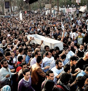The body of Gaber Salah, who died Sunday from injuries he suffered during clashes with security forces last week, is carried by fellow Egyptians on Monday in Cairo.