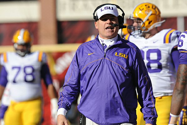 LSU coach Les Miles speaks Friday, Nov. 23, 2012, on the sidelines during the second quarter against Arkansas at Razorback Stadium.
