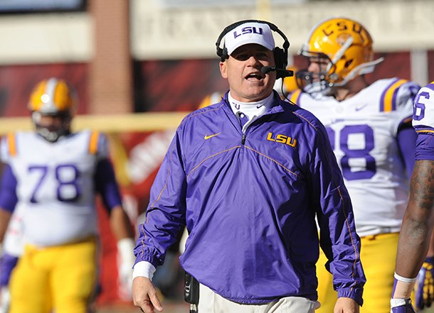 lsu-coach-les-miles-speaks-friday-nov-23-2012-on-the-sidelines-during-the-second-quarter-against-arkansas-at-razorback-stadium