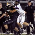 Alex Brignoni, Fayetteville senior defensive back, brings down Bentonville senior running back Garre...