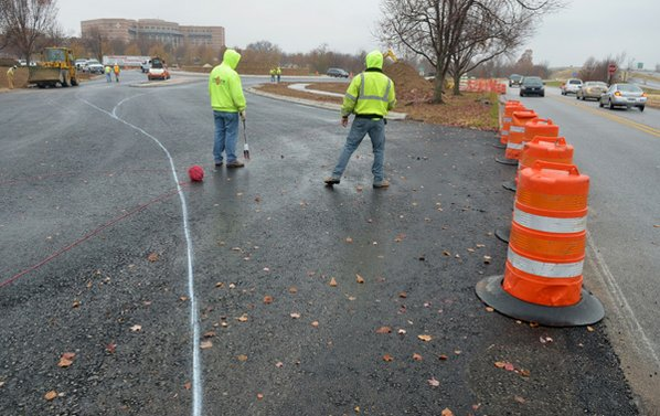 Construction crews mark the lines ...