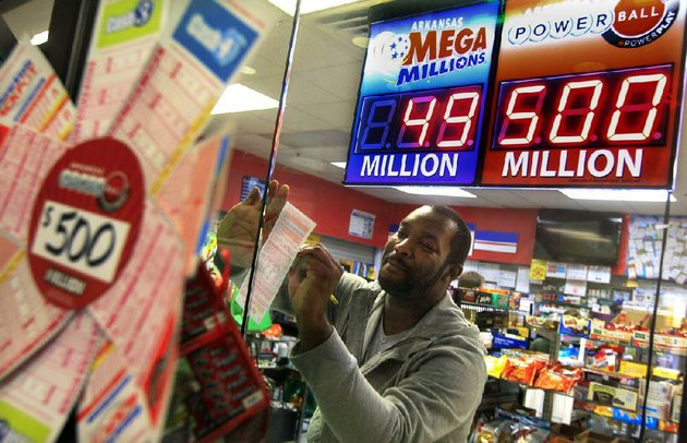arkansas-democrat-gazettebenjamin-krain-112712-jeremy-mccoy-picks-numbers-on-a-power-ball-lottery-ticket-at-sufficient-grounds-metro-store-in-little-rock-on-tuesday-the-jackpot-for-500-million-will-be-drawn-wednesday-night