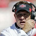 Arkansas State head coach Gus Malzahn watches the first half of their NCAA college football game aga...