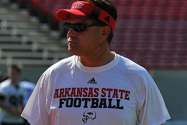 Arkansas State head coach Gus Malzahn looks on during a preseason practice in Jonesboro.
