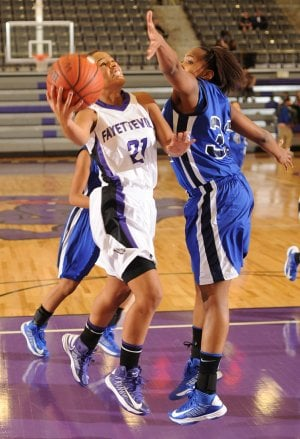 left, attempts to score past Conway sophomore forward Christin Rogers during