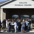 Mourners gather outside Rollins Funeral Home on Tuesday following a funeral service for 6-year-old J...