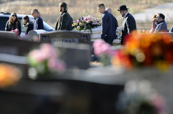 Relatives carry the casket of ...