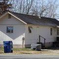 Police arrested Zachary Holly, 28, who lives in this home at 702 S.E. A St. in Bentonville on Monday...