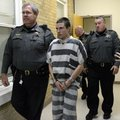 Zachary Holly, 28, of Bentonville is escorted by Benton County Sheriff's Deputies into Circuit Judge...
