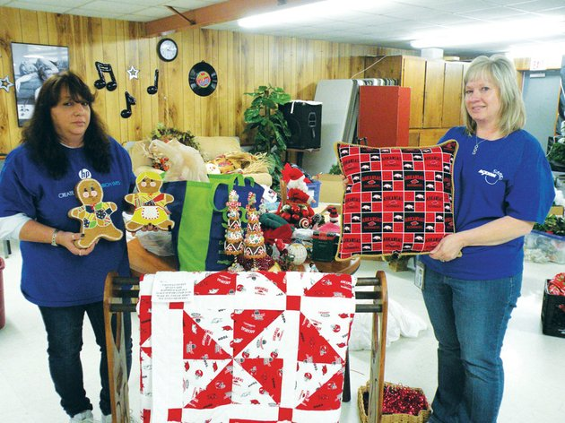 volunteers-jodi-jones-left-representing-hewlett-packard-and-judy-tipton-representing-acxiom-corp-lend-a-hand-monday-afternoon-in-decorating-the-conway-senior-wellness-and-activity-center-formerly-known-as-the-conway-senior-citizen-center-the-center-will-host-its-32nd-annual-pancake-breakfast-silent-auction-craft-and-bake-sale-from-7-am-to-noon-saturday-with-all-proceeds-benefiting-the-faulkner-county-senior-citizens-program-the-handmade-arkansas-razorback-quilt-and-pillow-will-be-given-away-during-a-drawing