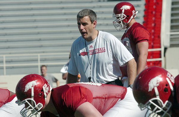 Arkansas Democrat-Gazette/MICHAEL WOODS -- Arkansas offensive line coach Chris Klenakis works with the offensive line during a 2010 practice at Razorback Stadium in Fayetteville.
