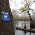 Prominent signs are placed at access areas along Arkansas Water Trails. The route is marked with sma...
