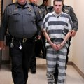 Zachary Holly, 28, of Bentonville is escorted Wednesday by Benton County Sheriff's Office deputies i...