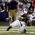 Jase Rapert, a Fayetteville junior, makes a reception against Rogers High during on Oct. 12 at Mount...