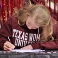 Amanda Dickerson of Rogers signed a letter of intent to compete in gymnastics for Texas Women's Univ...