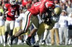 Georgia linebacker Alec Ogletree (9) takes down Georgia Techs' Synjyn Days for a loss during the third quarter of an NCAA college football game, Saturday, Nov. 24, 2012, in Athens, Ga. Georgia won 42-10. (AP Photo/John Amis)
