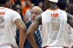 Syracuse head coach Jim Boeheim, center, talks with his players during a timeout against Princeton in the second half of an NCAA college basketball game in Syracuse, N.Y., Wednesday, Nov. 21, 2012. Syracuse won 73-53. (AP Photo/Kevin Rivoli)