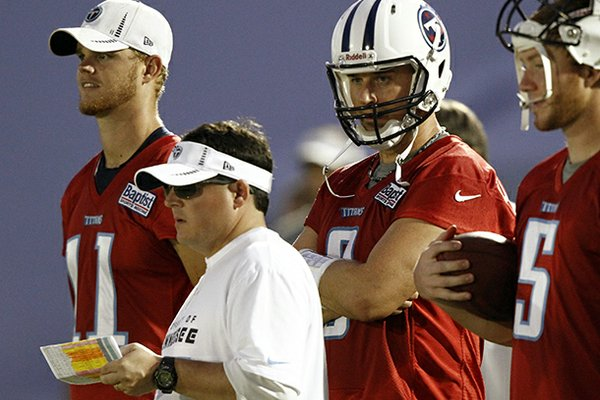 Tennessee Titans offensive coordinator Dowell Loggains, front, watches the quarterbacks during NFL football camp in Nashville, Tenn. (AP Photo/Wade Payne, File)