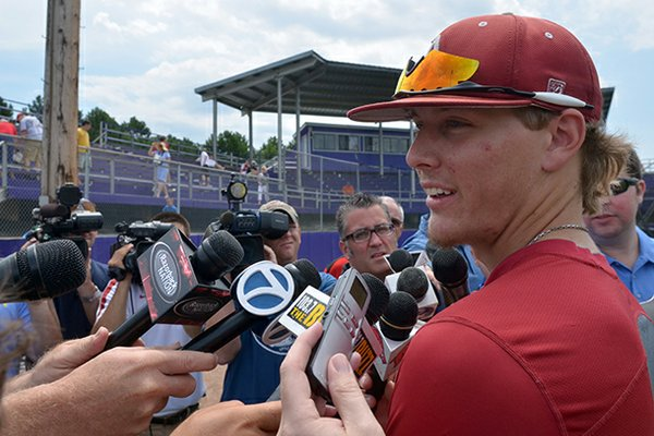 Arkansas Democrat-Gazette/MICHAEL WOODS -- Arkansas pitcher Ryne Stanek talks with reporters after a June practice in Bellevue, Neb.
