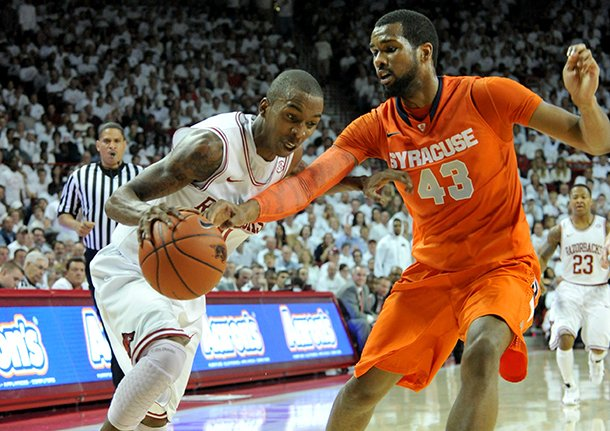 nwa-mediamichael-woods-11302012-arkansas-guard-bj-young-tries-to-get-past-past-syracuse-defender-james-southerland-during-the-first-half-of-friday-nights-game-at-bud-walton-arena-in-fayetteville