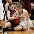 Taylor Lee, right, Bentonville senior, ties up a loose ball Thursday with Huntsville senior Sydney S...