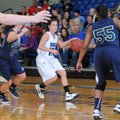 Cassandra Trexler, center, Rogers High, gets caught Thursday between Little Rock Christian's Annalee...