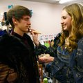 Lauren Suchy, Bentonville High School junior, helps senior Aaron Young with his makeup Thursday befo...