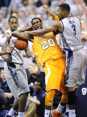 Georgetown forward Mikael Hopkins (3) and Greg Whittington (left) battle for the ball against Tennessee forward Kenny Hall (20) during Friday's game in Washington. Georgetown won, 37-36.