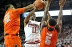 NWA Media/MICHAEL WOODS --11/30/2012-- Arkansas guard BJ Young is fouled by Syracuse defender DaJuan Coleman as he drives to the hoop during the first half of Friday night's game at Bud Walton Arena in Fayetteville.