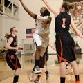 Jamayne Potts, center, Bentonville, takes the ball to the basket Saturday under pressure from Gravet...