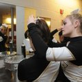Cici Betz, 16, right, helps Sarah Steiner, 15, both members of the Bentonville dance team, with her ...