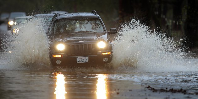 motorists-navigate-piner-road-friday-nov-30-2012-in-santa-rosa-calif-the-second-in-a-series-of-storms-slammed-northern-california-on-friday-as-heavy-rain-and-strong-winds-knocked-out-power-tied-up-traffic-and-caused-flooding-along-some-stretches