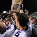 Players hoist the 7A football state championship trophy Saturday, after Fayetteville High repeated a...