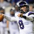 Austin Allen, Fayetteville quarterback, looks downfield for an open receiver Saturday in the third q...