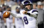 Austin Allen, Fayetteville quarterback, looks downfield for an open receiver Saturday in the third quarter of the game against Bentonville at War Memorial Stadium in Little Rock for the Class 7A football state championship.