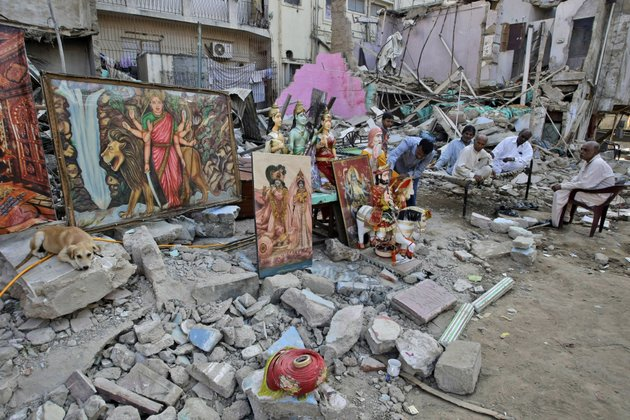 members-of-pakistani-hindu-community-sit-next-to-the-rubble-of-a-hindu-temple-which-was-destroyed-on-saturday-by-a-builder-in-karachi-pakistan-sunday-dec-2-2012-members-of-the-pakistan-hindu-community-in-the-southern-port-city-of-karachi-protested-on-sunday-over-the-destruction-of-a-hindu-temple-saturday-by-a-builder-who-claimed-that-the-land-is-his