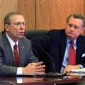 Jeff Long (left) speaks while UA chancellor David Gearhart listens during a UA Board of Trustees mee...