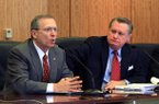 Jeff Long (left) speaks while UA chancellor David Gearhart listens during a UA Board of Trustees meeting in 2012.