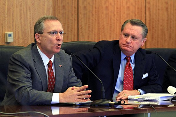 Jeff Long (left) speaks while ...