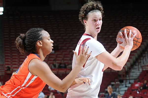 NWA MEDIA/SAMANTHA BAKER -- Arkansas' Sarah Watkins right, moves around the outside of Keitra Wallace of Pepperdine Sunday, Dec. 2, 2012, at Bud Walton Arena in Fayetteville. Watkins scored 18 points for the Razorbacks, beating Pepperdine, 64-39.