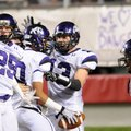 Fayetteville players celebrate after Jordan Dennis' interception and touchdown in the third quarter ...