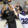 Jimmie Jackson, left, Bentonville, battles for the ball Saturday with Fayetteville's Cole Harris at ...