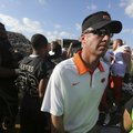 Oklahoma State coach Mike Gundy reportedly met with Arkansas following a loss to Baylor over the wee...