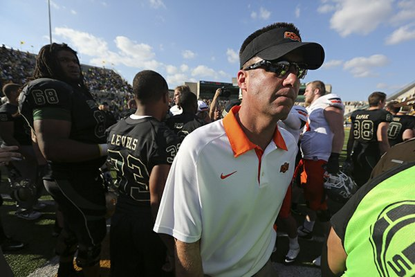 Oklahoma State coach Mike Gundy reportedly met with Arkansas following a loss to Baylor over the weekend.