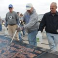 Mark Kruger, from left, Rick Stocker and James Willett grill chicken Saturday to raise money for the...