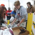 Ashley White, center, and other Heritage High School students wrap grilled chicken for sale on Satur...