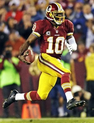Washington Redskins quarterback Robert Griffin III (above) threw for one touchdown and had a fumble turn into another score, and the Washington Redskins pulled within one game of the NFC East lead with a 17-16 victory over the New York Giants on Monday night.The Redskins improved to 6-6 with their third consecutive victory, tied with the Dallas Cowboys and on the heels of the Giants, who have lost three of four to fall to 7-5. Griffin completed 13 of 21 passes for 163 yards and ran five times for 72 yards, breaking Cam Newton's NFL record for yards rushing by a rookie quarterback with 642 yards this season. Griffin lost the ball on one of his runs, but it flew into the arms of teammate Joshua Morgan, who ran it in for an early touchdown.