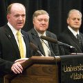 Idaho's new football coach, Paul Petrino, left, speaks while university President Duane Nellis, cent...